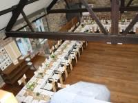 salle polyvalente à DOURBES avec plancher en bois